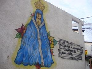 Imagem de Nossa Senhora pintada no muro