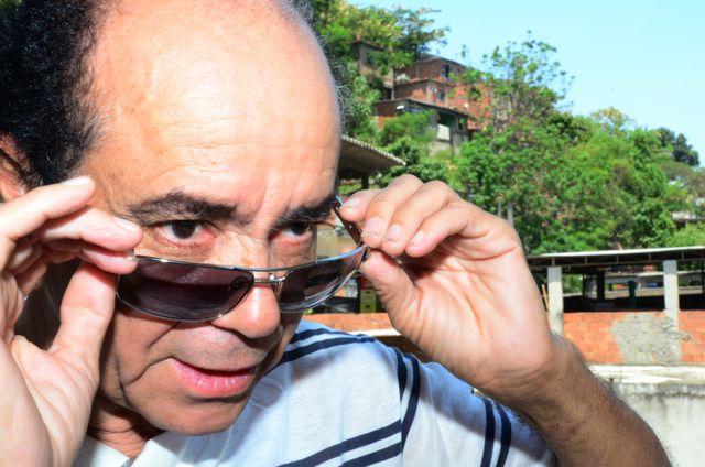 Manoel Rodrigues Moura, 58, fotógrafo e morador do Complexo do Alemão