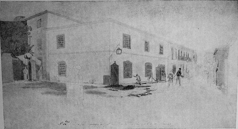 """""""O Aljube"""", mais tarde Cadeia da Relação, situada na Rua da Prainha, atual Rua do Acre. A figura presa por grilhões à direita nos sugere qual era a população que, já naquela época, era criminalizada e encarcerada. Gravura de Thomas Ender (c. 1817)."""