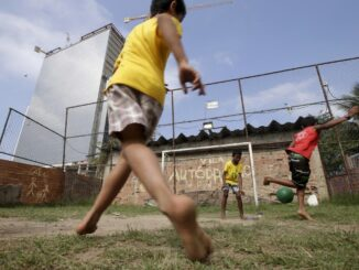 """Children play soccer in the Vila Autodromo slum in Rio de Janeiro, Brazil, July 28, 2015. As sports arenas rise up around them and neighbours' houses are demolished, around 50 families remain in Vila Autodromo, a favela bordering the Olympic Park in Rio de Janeiro. About half of those refuse to leave the favela, which they describe as """"paradise"""" because of a lack of violence compared with poor areas elsewhere in the city. With a year until the Games come to Brazil, over 90 percent of residents have already left after accepting compensation. The holdouts, despite violent run-ins with police, vow to fight eviction whatever the cost. Living in a ghost town with sporadic access to water and electricity, the families have become a symbol against the use of the Olympic Games to modernize Rio, a move critics say is only benefiting the rich. REUTERS/Ricardo Moraes TPX IMAGES OF THE DAYPICTURE 6 OF 28 FOR WIDER IMAGE STORY """"FIGHTING OLYMPIC EVICTION IN RIO FAVELA"""" SEARCH """"RICARDO PARADISE"""" FOR ALL IMAGES 'Ä® TPX IMAGES OF THE DAY - RTX1Q0DR"""