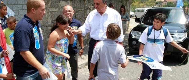 Pezão visita comunidade de Santo Amaro quando candidato ao governo do Rio em 2014. Foto: Marcio Cassol.